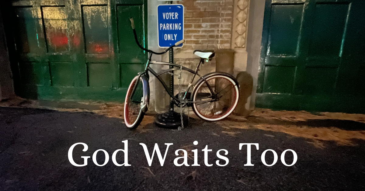 "God waits too words with empty bike resting under ""Voter Parking Only"" sign"